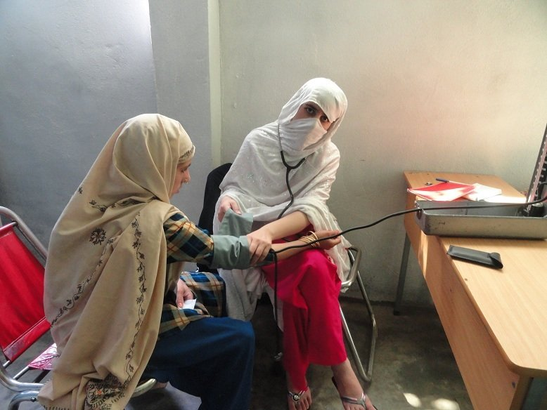 A mother in Swat receives medical attention