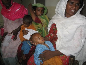 An infant facing severe dehydration receives care