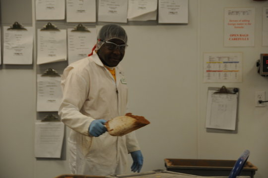 Freeman measures out the dry ingredients.