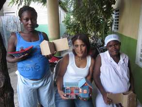 Members of the Microenterprise Project and houses!