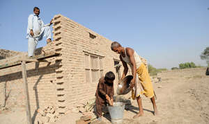 Arsalan,10 helped his farther building their house