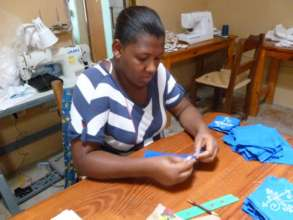 Katiana Works on a Haiti Projects Sachet