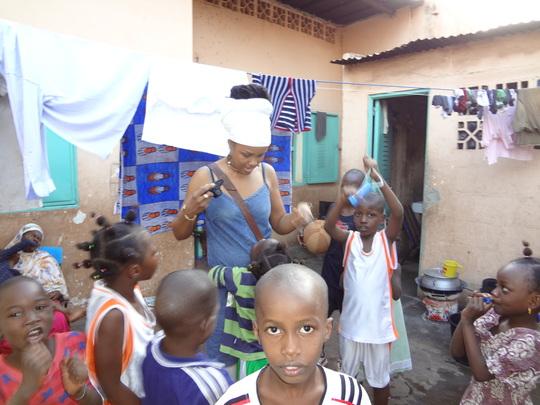 Children enjoying activities with Mrs. Harris