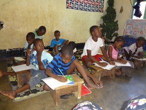children doing homework at the orphanage