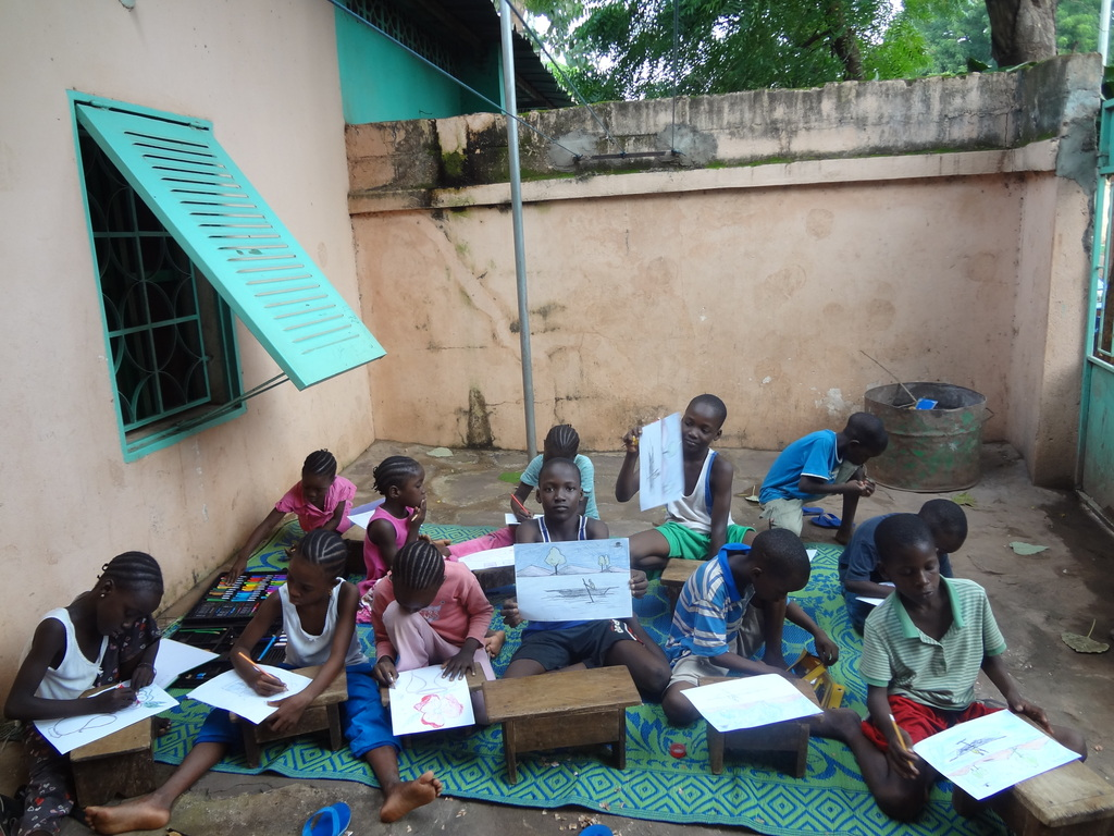 Chidren drawing and coloring at the orphanage