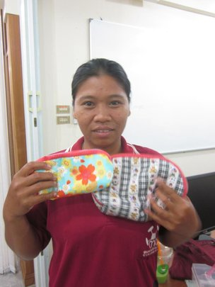 Aea shows her first fabric bag.