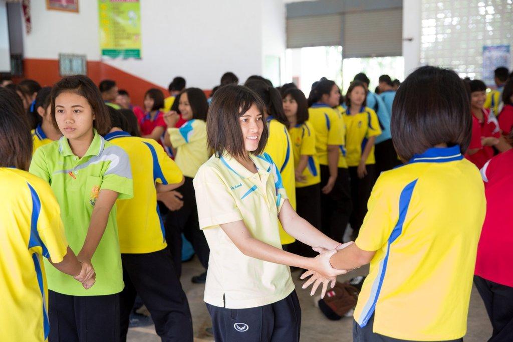 Grade-nine school girls learning self-defense