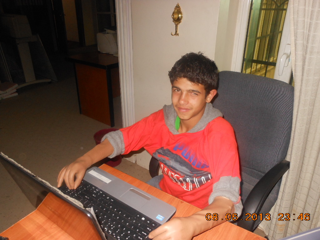 June 2013 - Mohammad typing with prostheses