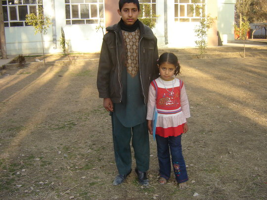 Safa on her way to school with her brother