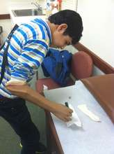 Mohammad writing with his new arm/hand