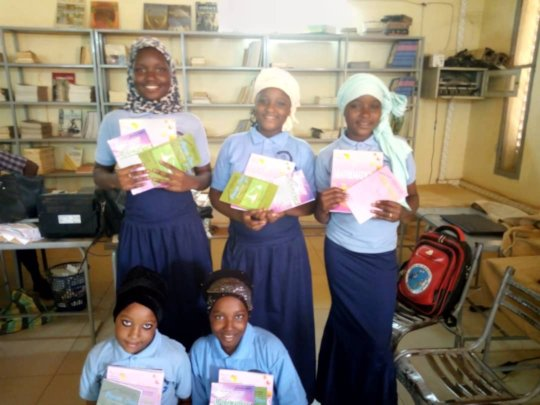 Middle School students with books