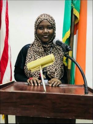 Hafsa giving speech at business university