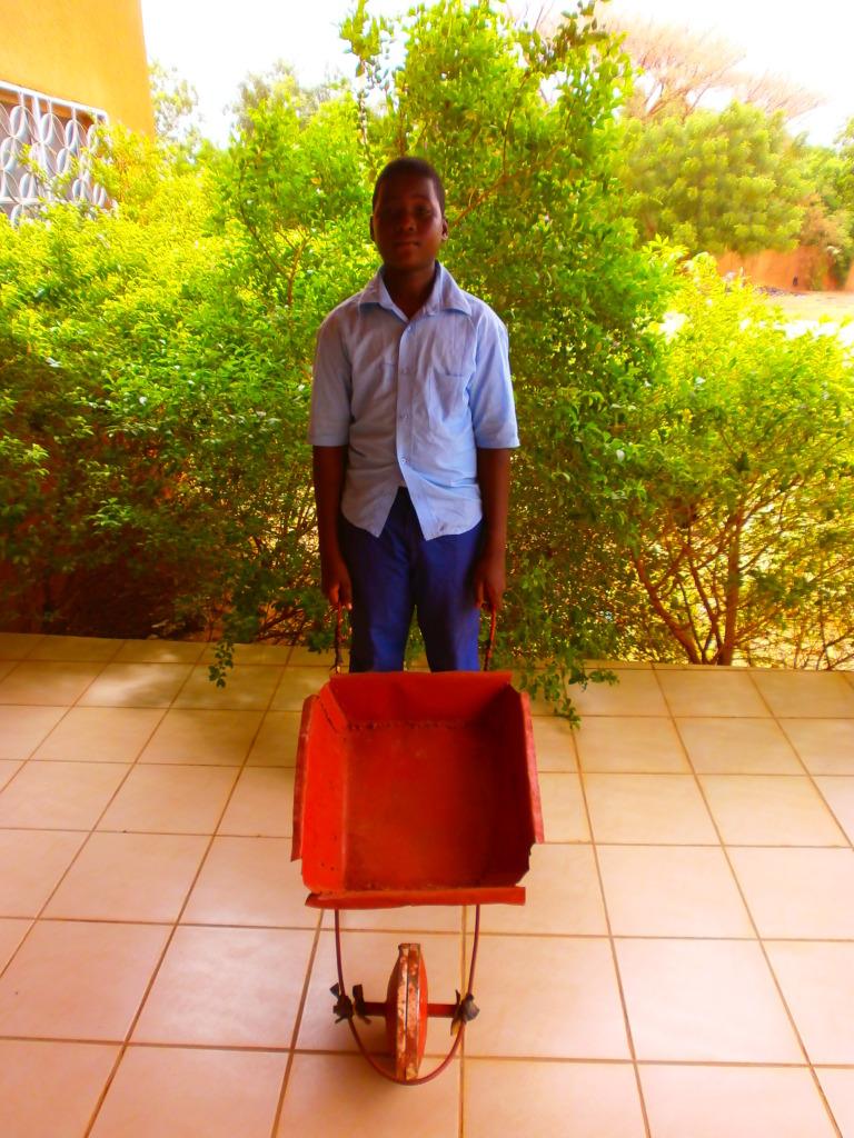 Ibrahim with his wheelbarrow
