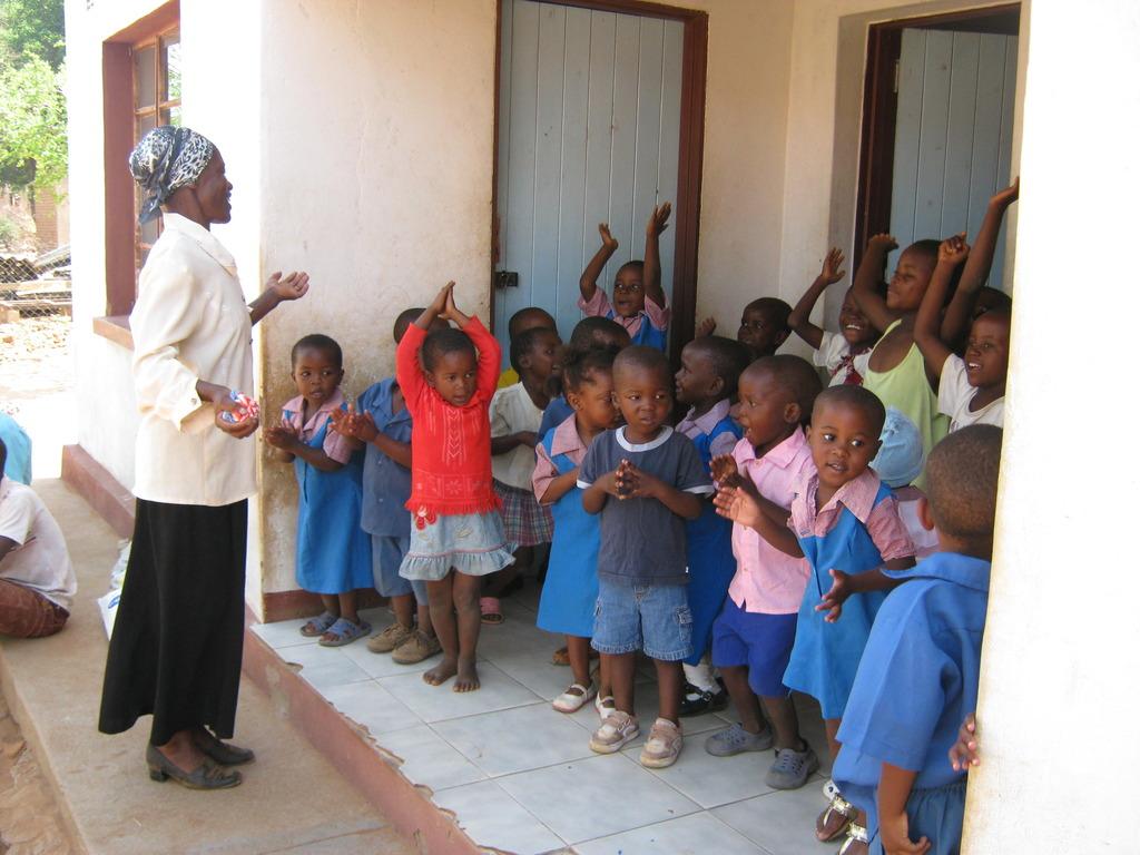 Pre-school kids with their teacher