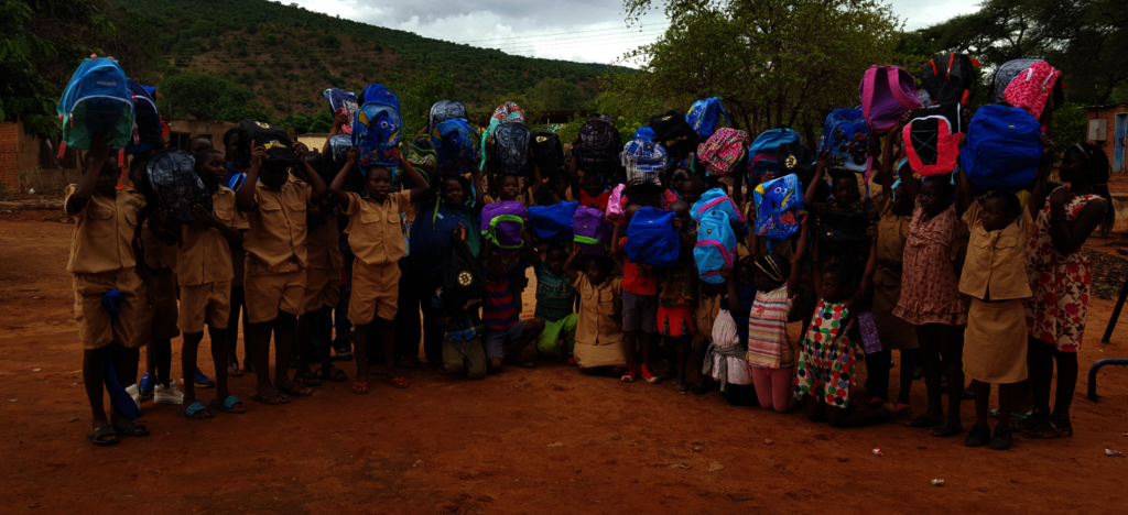 Kids Receiving Backpacks