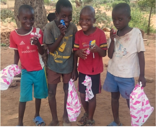Kids All Smiles After Receiving Christmas Gifts