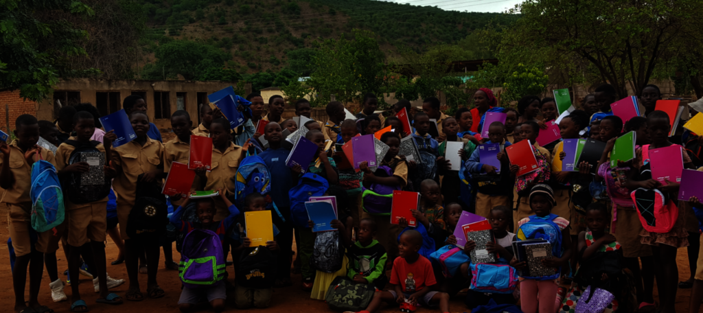 Kids Receiving Notebooks