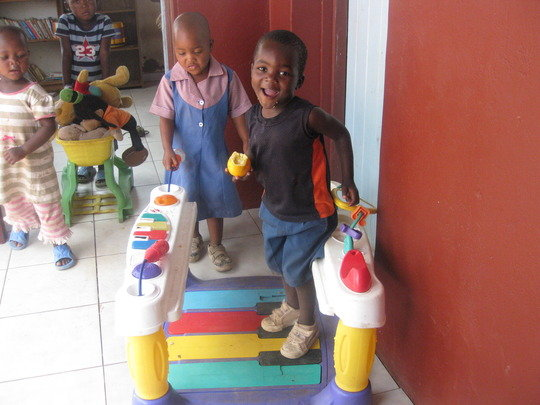 Kids who attend our pre-school playing with toys