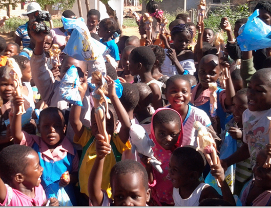 Kids receiving toys during Christmas