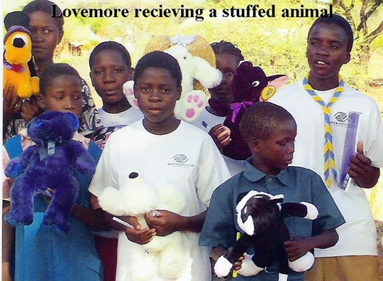 Lovemore receving a stuffed animal