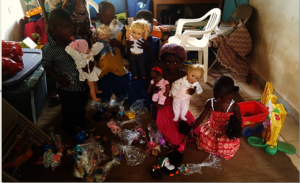 Kids Playing With Toys Donated To Pre-school