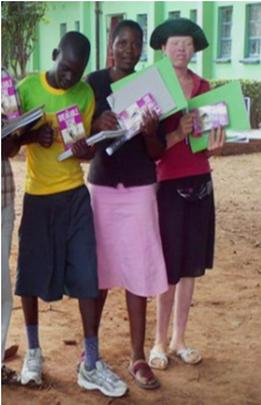 Nomore Mlambo on the left receiving notebooks