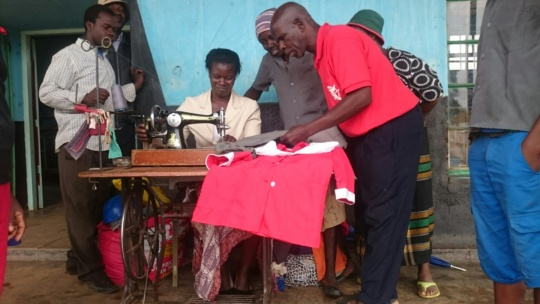 Rural Youth Receiving Sewing Lessons
