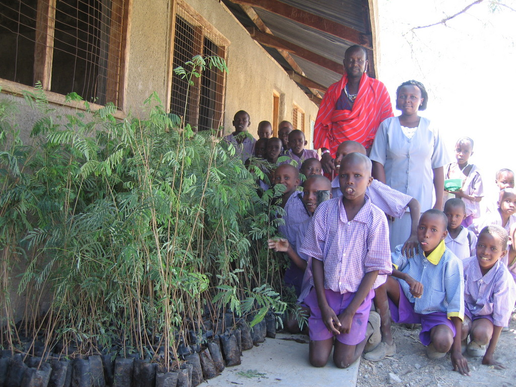 Children happy to receive trees for planting.