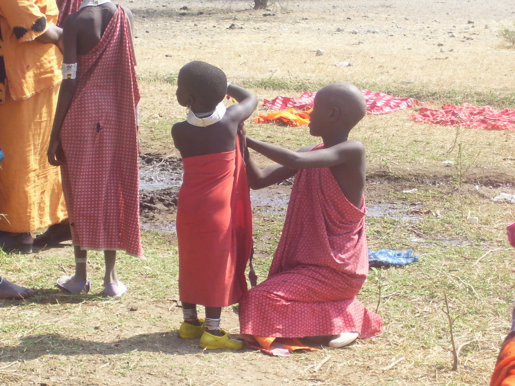 Children have to carry a heavy load in the desert areas of Afric