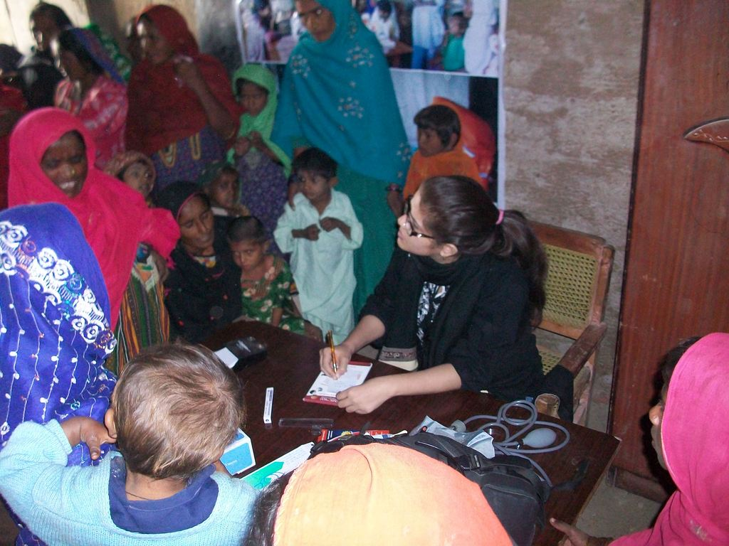 Dr. Sarah checking patients in medical camp