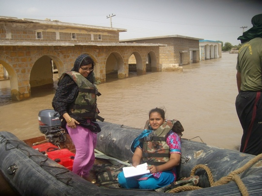 AHD staff in boat to rescue some women