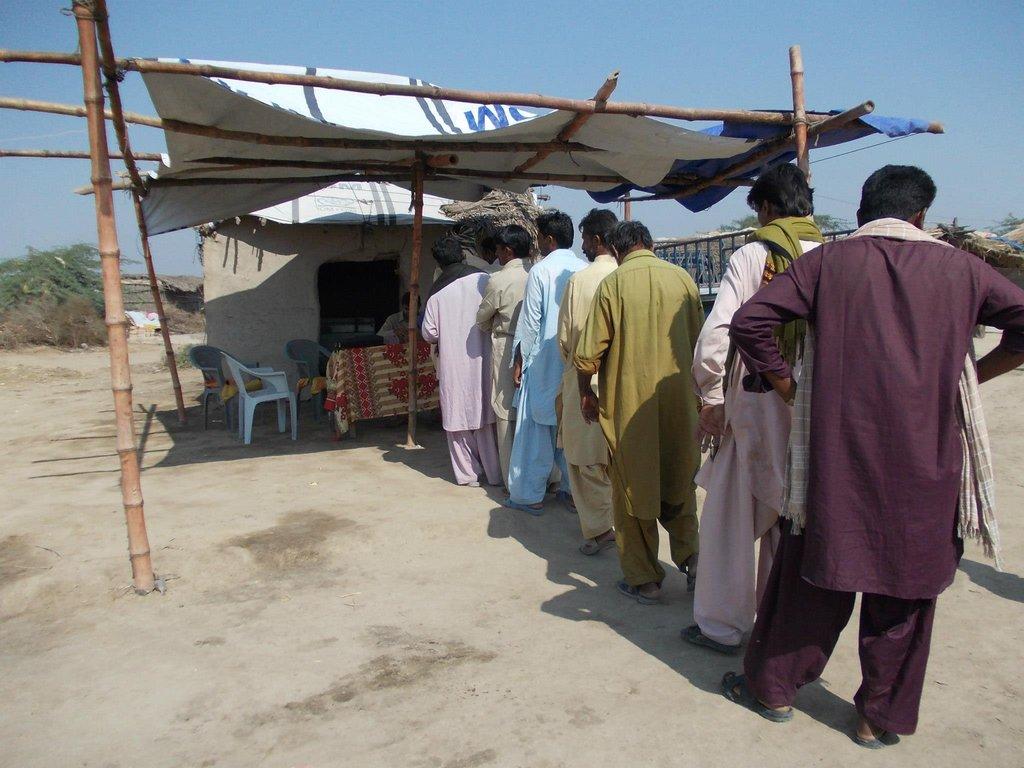 Food token distribution among 2012 Flood victims