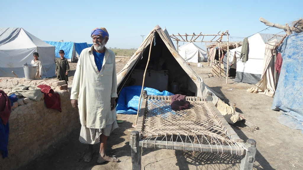 Villager showing thier house at Village