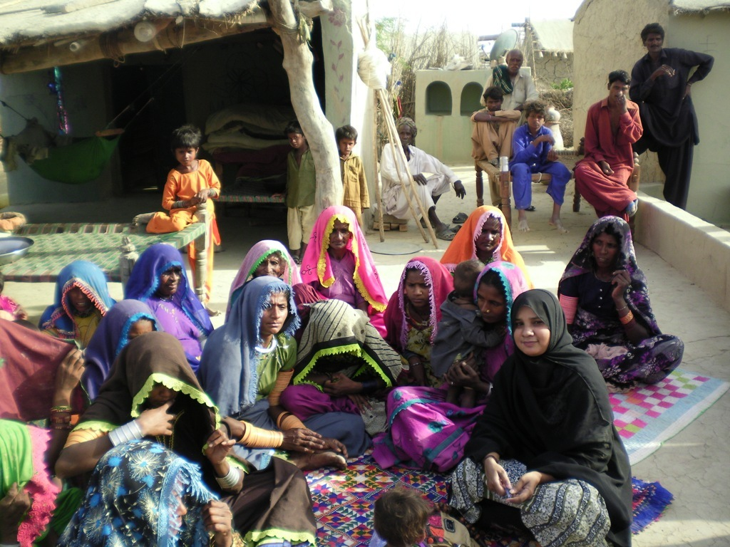 Women sharing their needs food & medical aid