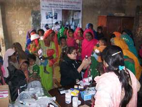 AHD mobile team in a village for medical camp