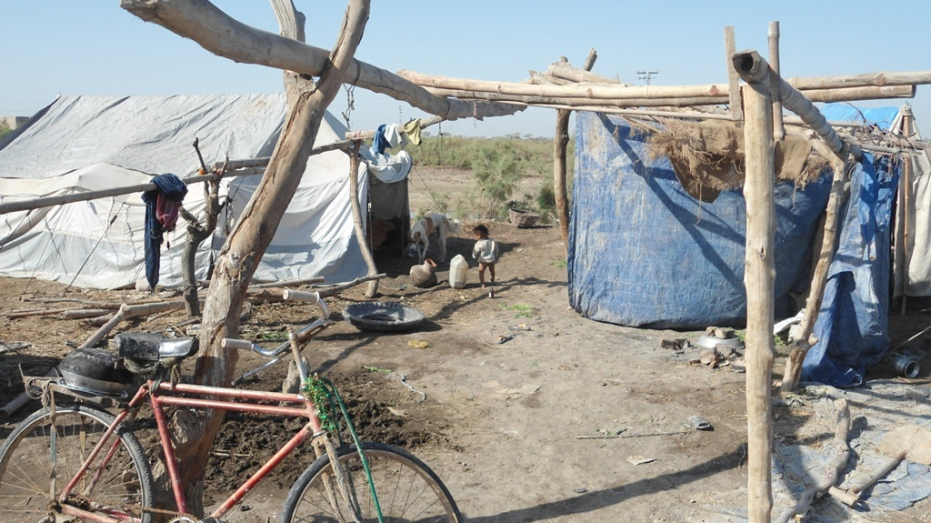 villagers living in distroyed shelter