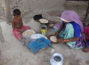 women making chapati for her family