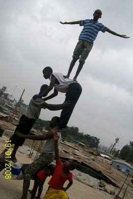 GSCH Tumbling Club with Mathare Slum in Back
