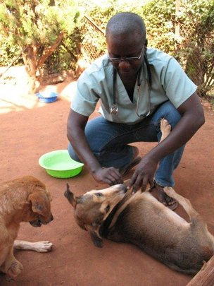Dr. Alex Mugisa, USPCA vet, with Hope
