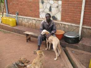 Robert, Haven caretaker, with dogs