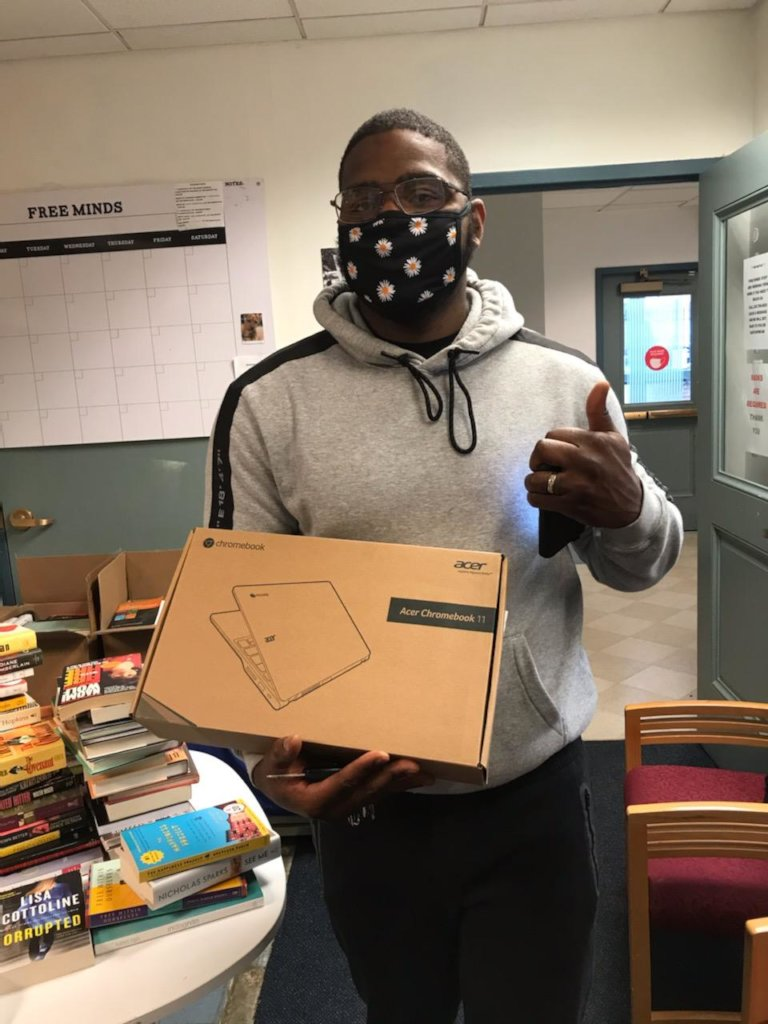 Lamarzs picking up a laptop for virtual programs