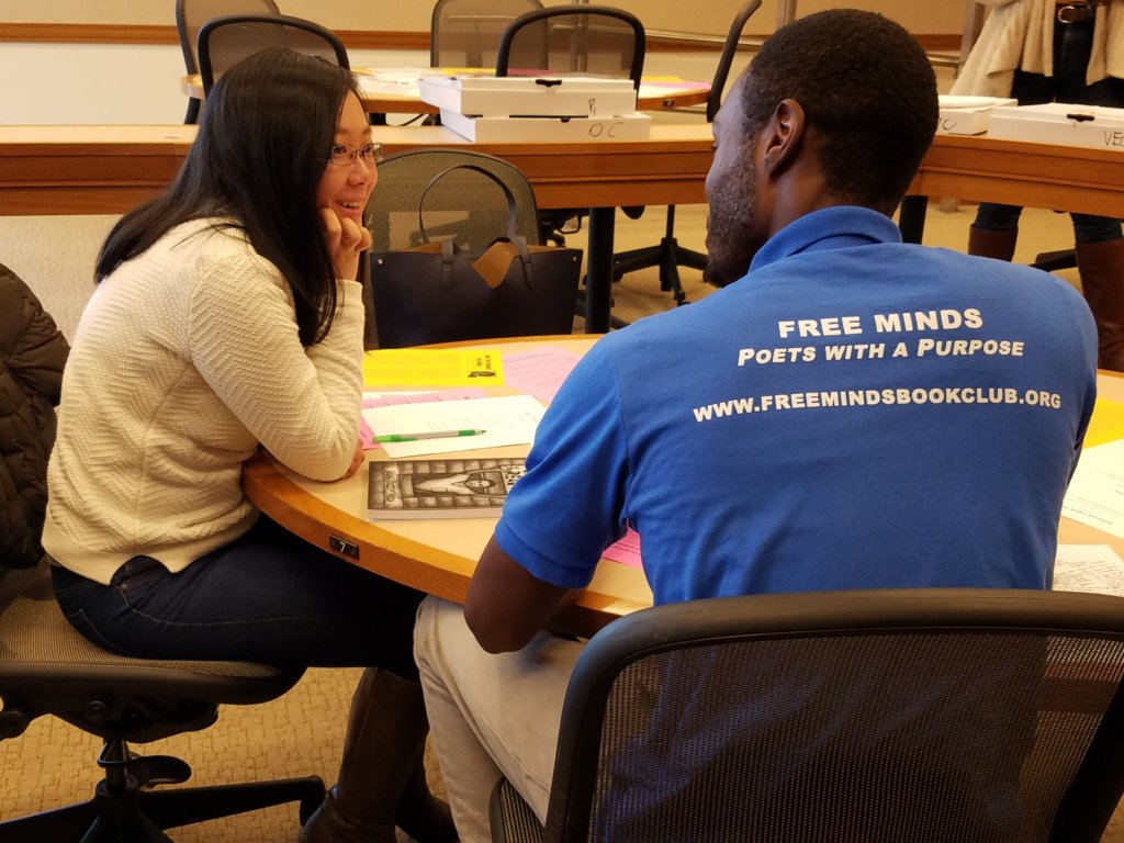 Hosea speaks with a student at Harvard Law School