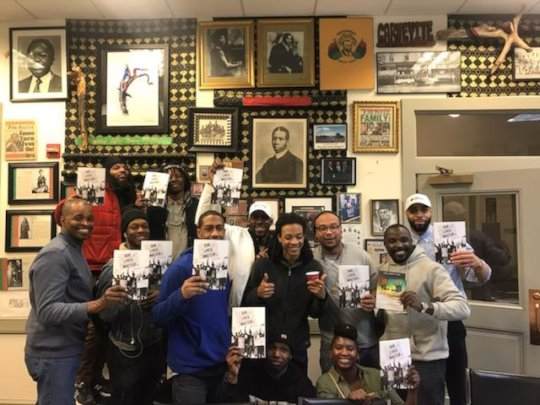"""Reentry Book Club poses with """"Our Lives Matter"""""""