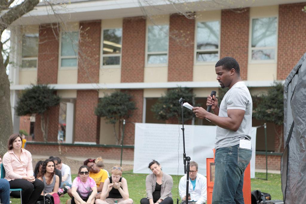 Poet Ambassador Anthony reads a poem at an event