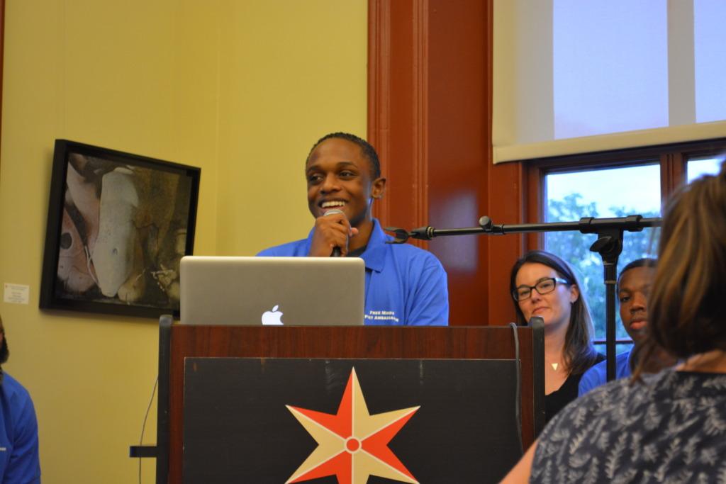 Caleb speaking to volunteers at Write Night