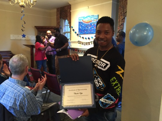 Free Minds Apprenticeship Graduate Charles!