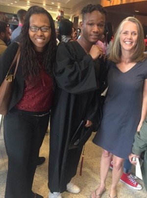 Lorenzo with Free Minds staff at his graduation