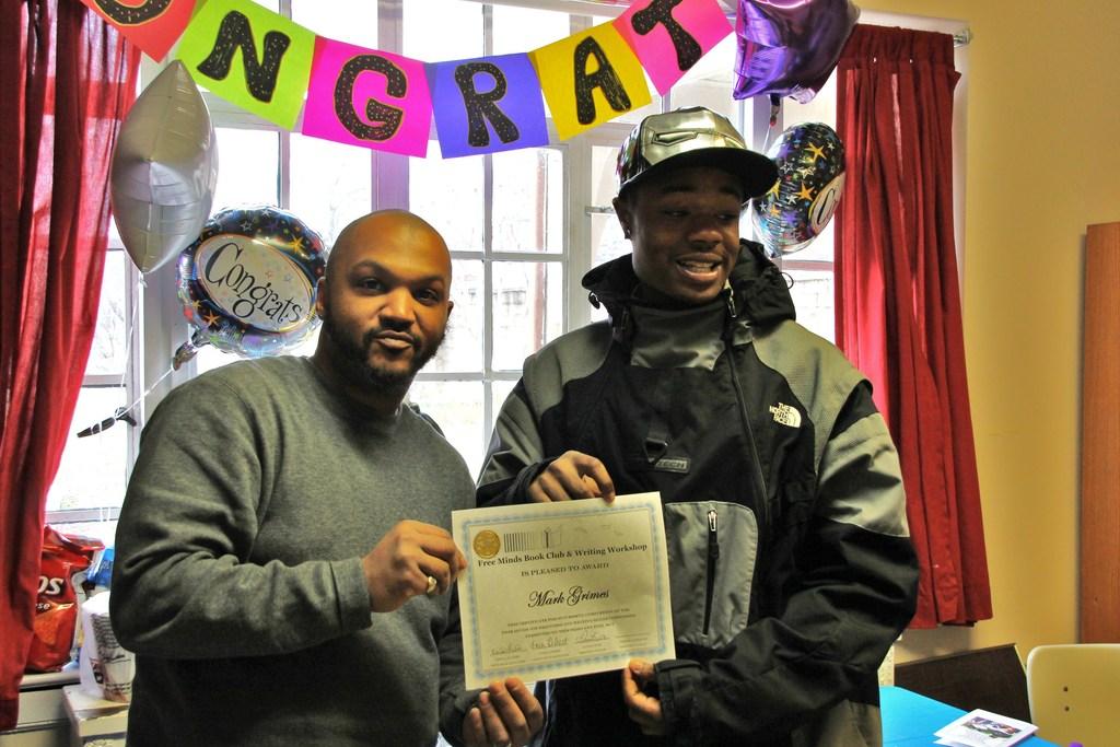 Member Mark receives his graduation certificate