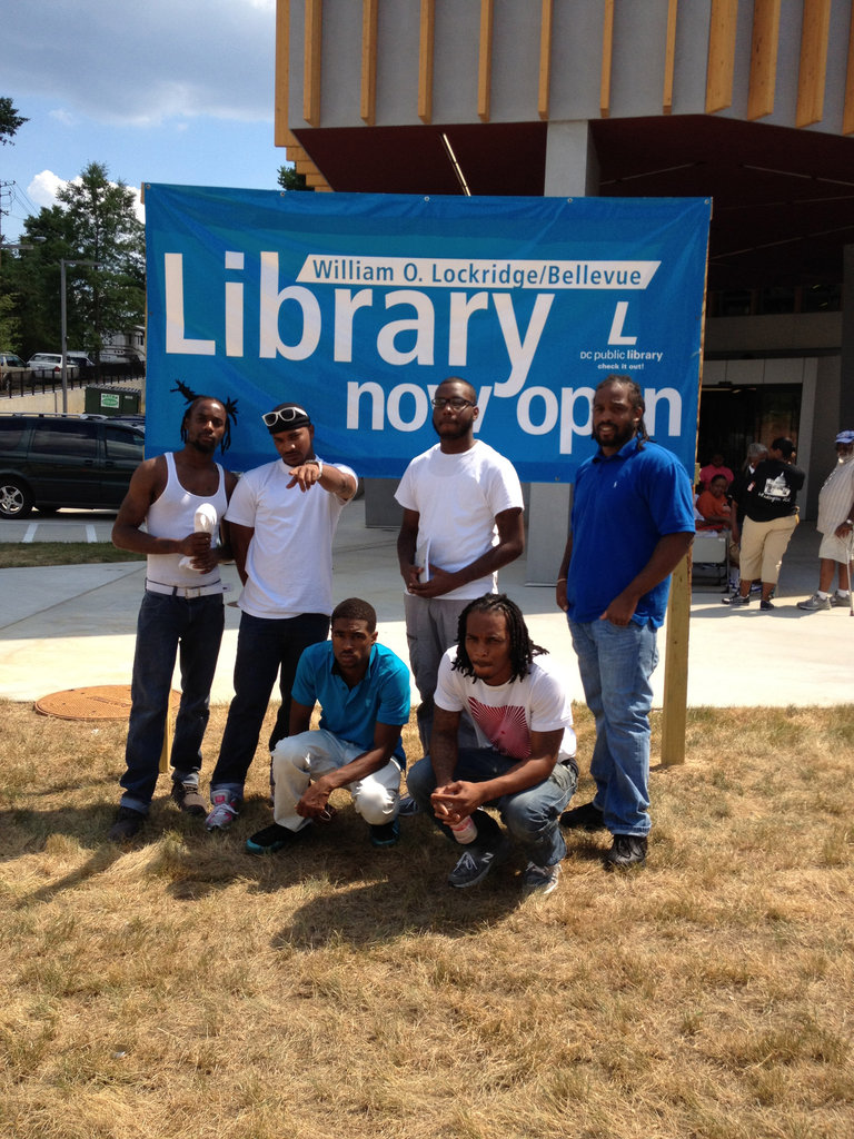 FM members sharing poetry at a library opening