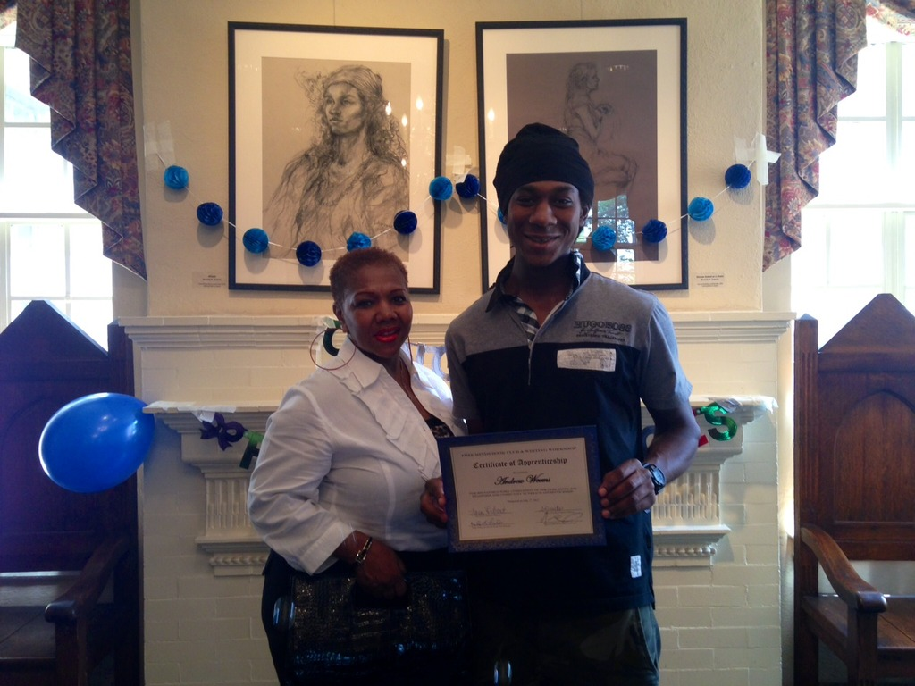Andrew and his mother at the June graduation